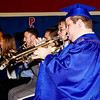 Mark Maynard | for The Herald Bulletin<br /> Graduating senior trumpeter Derick DeLong plays his final number with the Elwood High School Band prior to commencement in the gymnasium.