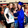 Mark Maynard | for The Herald Bulletin<br /> Members of the Porter family, Tarra, Riley, Brady and Valerie, congratulate Destiny Porter following her graduation from Elwood High School on Sunday afternoon.