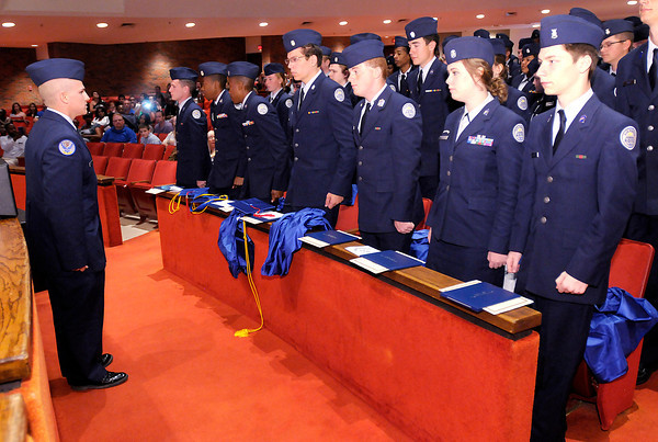 Don Knight | The Herald Bulletin<br /> Anderson Preparatory Academy's 58 graduating seniors stand at attention as AFJROTC Cadet Commander Jarred Beckley, left, gives them the command to about face and salute the academy one final time during APA's graduation ceremony at Reardon Auditorium on Sunday.