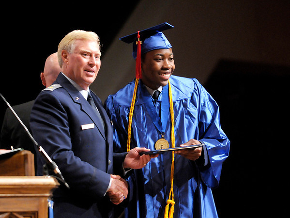 Don Knight | The Herald Bulletin<br /> Terrell Barnes poses for a photo with Commandant Robert Guillaume during Anderson Preparatory Academy's graduation ceremony at Reardon Auditorium on Sunday.