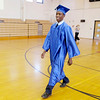 De'Vaughn Terrell Wright walks into the gym during the processional as Anderson Preparatory Academy held their first graduation on Saturday.