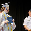 Cassandra Ivy Gatton reacts after receiving her diploma during Anderson Preparatory Academy's first graduation on Saturday.