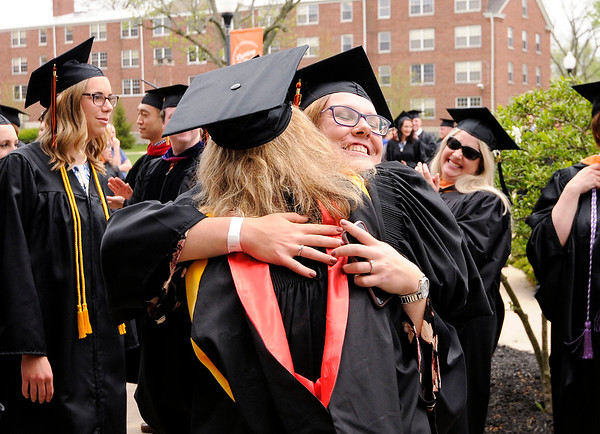 Don Knight | The Herald Bulletin<br /> Professors congratulate their students as the procession enters Kardatzke Wellness Center as Anderson University held their 100th Commencement on Saturday.