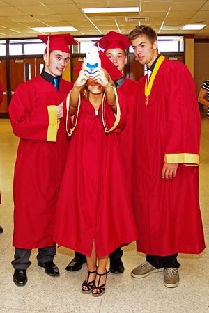 Graduating Alexandria-Monroe High School student Taylor Sells snaps a photo of herself and classmates Thomas Kapoun, Blake Buckles and Mason Ward prior to Commencement.
