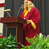 """Alexandria-Monroe High School Senior Class President Shelby Farmer speaks to her classmates prior to the traditional slide show of the graduates """"then and now."""""""