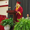 "Alexandria-Monroe High School Senior Class President Shelby Farmer speaks to her classmates prior to the traditional slide show of the graduates ""then and now."""