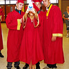 Graduating Alexandria-Monroe High School student Taylor Sells snaps a photo of herself and classmates Thomas Kapoun, Blake Buckles and Mason Ward prior to Commencement.
