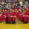 Members of the Alexandria-Monroe High School Class of 2014 await their diplomas.