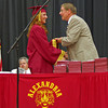 Allie Hueston receives her diploma from retiring Alexandria-Monroe Principal Jim Regenold.