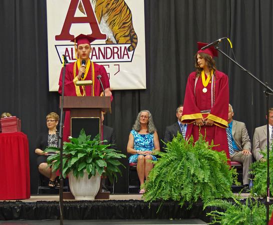 Alexandria-Monroe High School Valedictorian Craig Doty addresses his classmates during the Commencement ceremony as Salutorian Desirae Litchfield looks on.