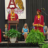 Alexandria-Monroe High School Valedictorian Craig Doty addresses his classmates during the Commencement ceremony as Salutorian Desirae Litchfield looks on.