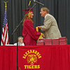Allie Hueston receives her diploma from retiring Alexandria-Monroe Principal Jim Regenold.