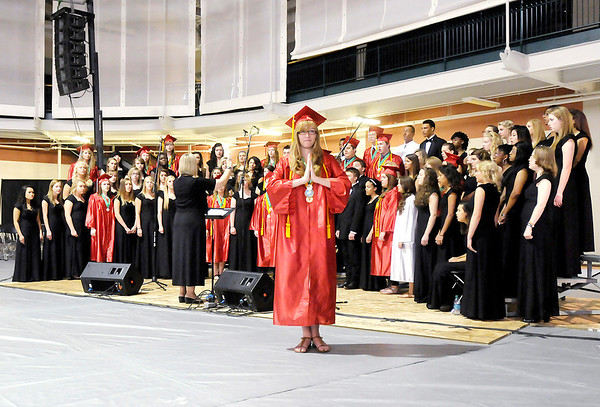 The Anderson High School Choral Department and American Sign Language Class perform during Anderson's graduation at the Kardatzke Wellness Center on the campus of Anderson University on Sunday.
