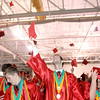 Stephen Carl tosses his cap into the air during the Anderson High School graduation at the Kardatzke Wellness Center on the campus of Anderson University on Sunday.