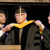 Robert W. McCurdy, center,  was bestowed a honorary Doctor of Science degree during Anderson University's Commencement exercise Saturday.