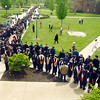AU graduates march through campus to Kardatzke Wellness Center where the faculty is lined up to greet them as they enter.