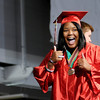 Kiara Woods gives a thumbs up as she receives her diploma on Sunday.