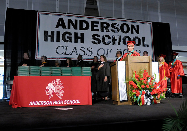 Vice President of the Class of 2012 Luke Stafford leads the audience in reciting the Pledge of Allegiance.