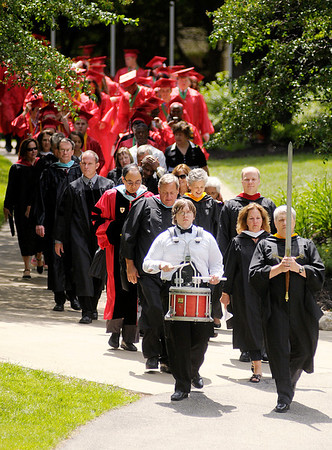 Anderson High School's Class of 2012 walks through the valley on their way to the the Kardatzke Wellness Center on Sunday.