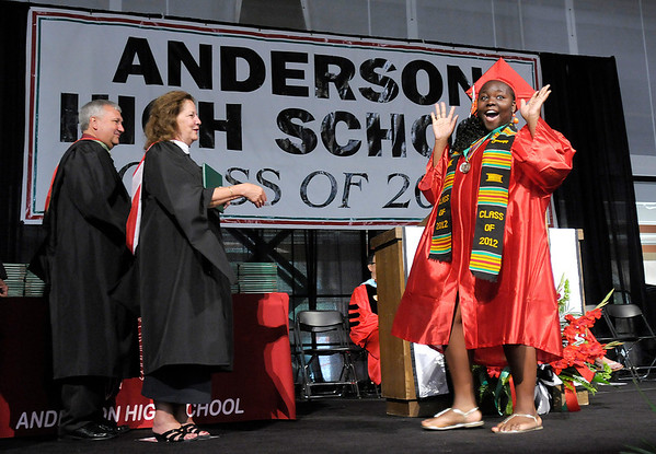 Rubria Horton reacts as she receives her diploma.