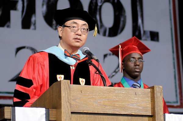 Superintendent Felix Chow gives the confirmation of the Class of 2012.