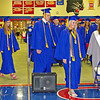 Class President Alexa Middlesworth, Salutatorian Joel Moser and Valedictorian Cecily Swinford approach the dias during the commencement processional.