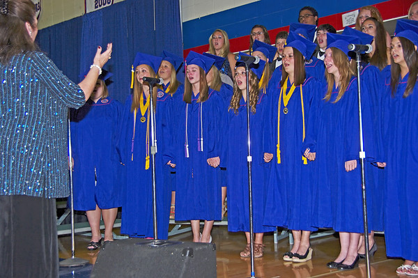 "Graduating choir members clasp hands while delivering an emotional final performance of ""Until We Sing Again."""
