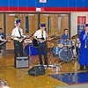 "The band ""Simple Solution"" composed of graduating seniors Justin Wiand (bass), Nick Wiand (lead guitar), Dillon Bogard (back-up guitar), Austin Charlton (vocals) and sophmore Derek Wiand (drums) perform the senior class song ""No Such Thing"" by John Mayer."