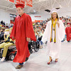 "Don Knight | The Herald Bulletin<br /> Shania Ray gives a thumbs up to her family as graduates file in as the band plays ""Pomp and Circumstance"" during Frankton's graduation on Friday."