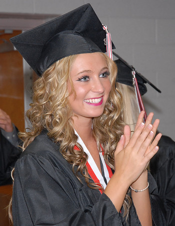 Frankton senior Alexa Munger enters the gymnasium for commencement.