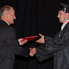 Frankton Lapel superintendent Bobby Fields shakes hands with a graduating senior.