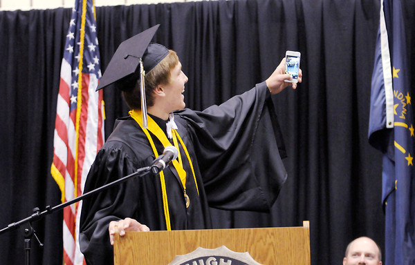 Don Knight | The Herald Bulletin<br /> Class President Bobby Steele takes a selfie with his classmates in the background as he gives his graduation speech during the Lapel High School graduation on Saturday.