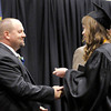 Don Knight | The Herald Bulletin<br /> Sierra Cash hands principal Chad Kemerly a toy soldier after receiving her diploma during Lapel High School's graduation on Saturday. Students each handed Kemerly a toy soldier as a class prank.