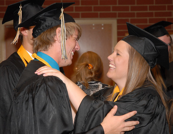 Seniors wish one another good luck before commencement.
