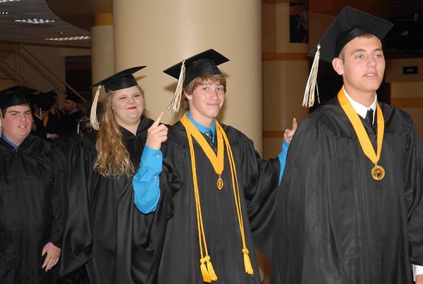 Seniors enter gymnasium for commencement.