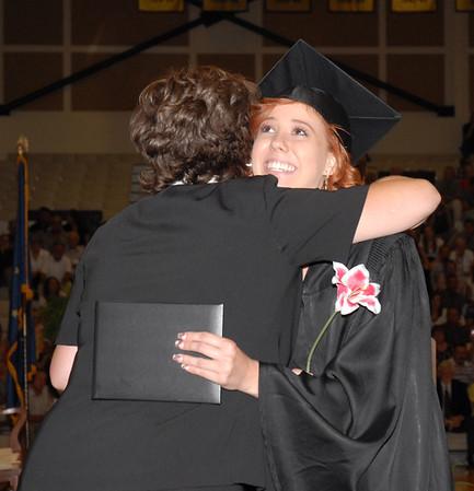 Morgan Baker gets a hug from senior class sponsor Kim Murdock after receiving her diploma.