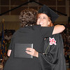 Morgan Baker gets a hug from senior class sponsor Kim Murdock after receiving her diploma.