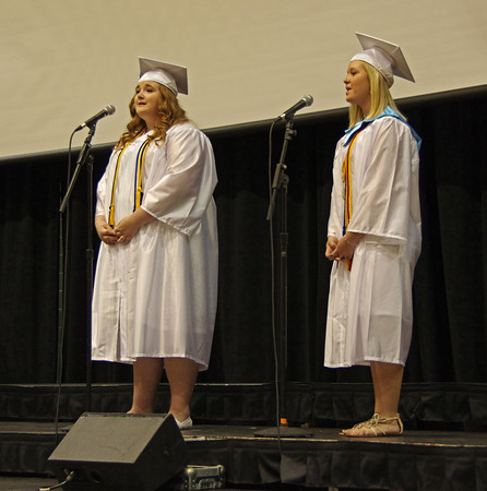 Kaitlyn Dowden and Peyton Spaugh sing a duet during Pendleton Heights High School graduation.