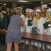 Pendleton Heights High School graduates collect their certificates after the conclusion of commencement.