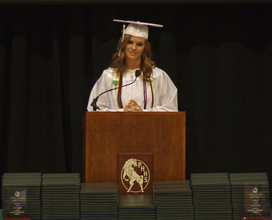 Pendleton Heights High School Senior Class President Audrey Dowden welcomes her classmates and guests to graduation ceremonies.