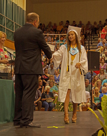 Pendleton Heights High School graduating Senior Taylor Fiew is presented with her diploma.