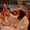 Kennedy Suarez holds her candle aloft during Pendleton Heights High School graduation ceremonies.