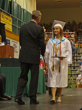 Heather Wendling accepts her diploma during Pendleton Heights High School graduation.