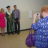 Pendleton Heights High School graduates pose for pictures with family after commencement on Sunday.