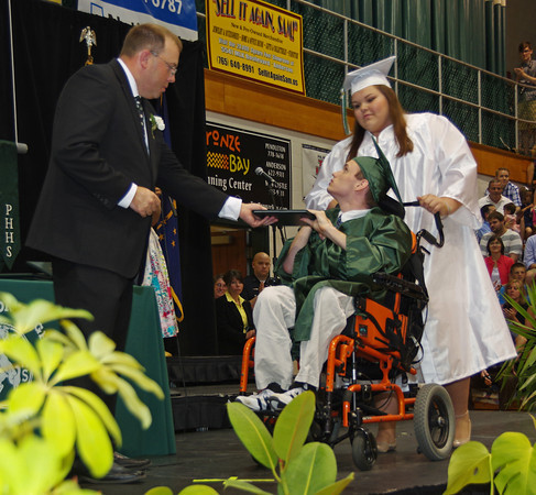 Braady Trump recieves his diploma during Pendleton Heights High School graduation.