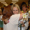 Graduate Shelby Bailey receives a hug from Pendleton Heights world language teacher Janine Taulman