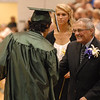 South Madison Community School Board member Terry Aucker congratulates foreign exchange student Francisco Batista after receiving his diploma.