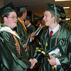 Josh Morrow and Matt Soverns shake hands after commencement.