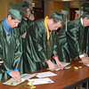 Seniors receive their official diplomas in the school cafeteria after commencement.