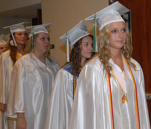 Seniors enter the gymnasium for commencement.